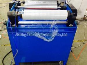 Hand stretch film roll winder